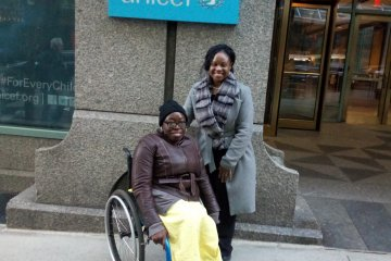 Toyin in front of the UNICEF building in New York